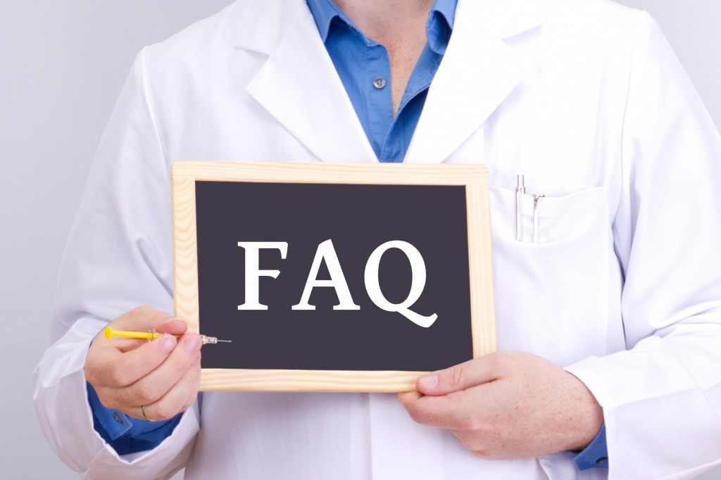 Doctor shows information on blackboard: faq