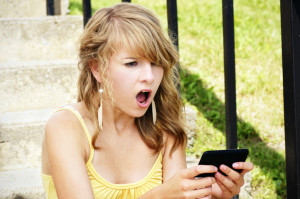 Young girl shocked by text message