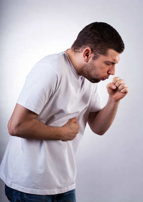 man coughing from asthma
